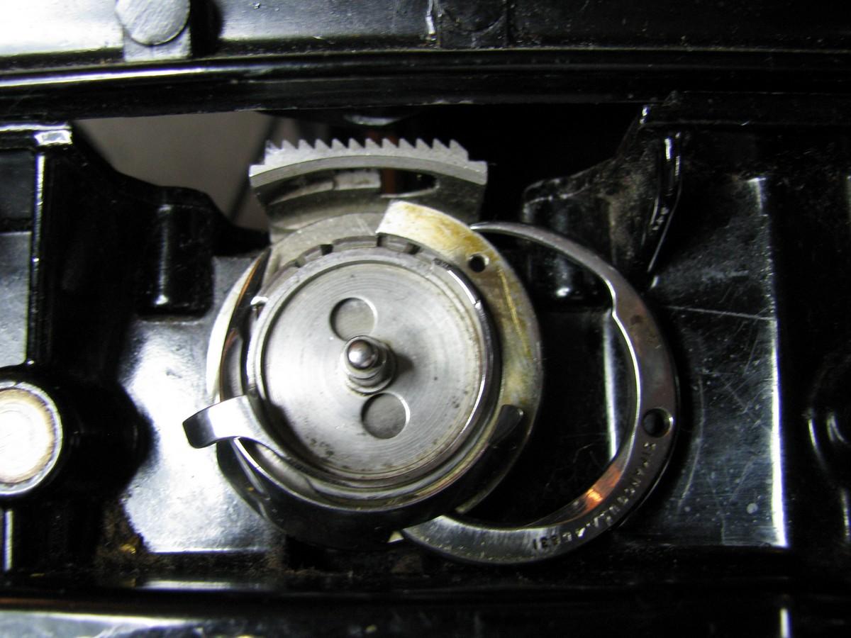 sewing machine jams bobbin area